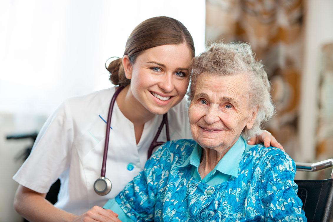 Woman nurse with elderly woman